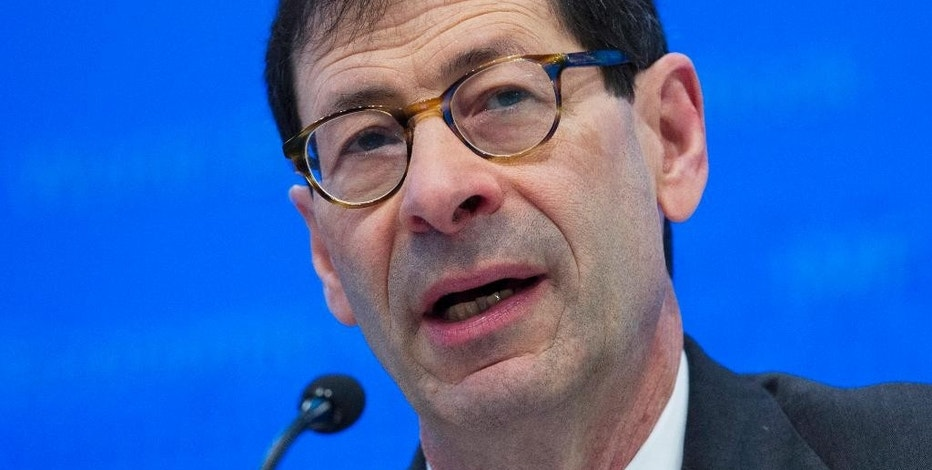 "FILE - In this Tuesday, Oct. 4, 2016, file photo, International Monetary Fund Economic Counsellor Maurice Obstfeld speaks at a news conference during the World Bank/IMF Annual Meetings, at IMF headquarters in Washington. The IMF announced Monday, Jan. 16, 2017, it is raising its forecast for the U.S. economy in 2017 and in 2018, reflecting an expected boost from the economic policies of President-elect Donald Trump. ""The global economic landscape started to shift in the second half of 2016,"" Obstfeld said, helped by a rebound in manufacturing activity in many countries and the financial market rally that started with Trump's November election victory. (AP Photo/Jose Luis Magana, File)"