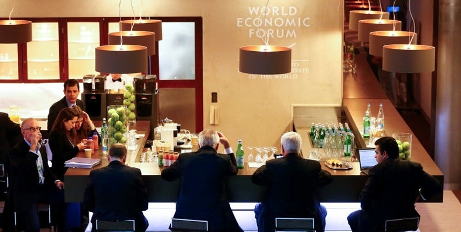 FILE PHOTO: Participants sit at a bar during the annual meeting of the World Economic Forum (WEF) in Davos, Switzerland January 21, 2016. REUTERS/Ruben Sprich/File Photo