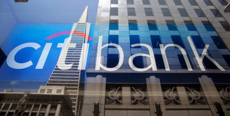 FILE - In this July 9, 2014, file photo, the Transamerica Pyramid is reflected in the window of the main branch of Citibank in the Financial District of San Francisco. Citigroup Inc. reports financial results Wednesday, Jan. 18, 2017. (AP Photo/Eric Risberg, File)