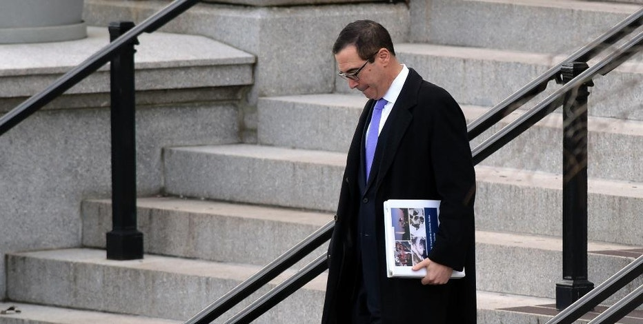 FILE - In this Jan. 13, 2017, file photo, Treasury Secretary-designate Steven Mnuchin walks down the steps of the Eisenhower Executive Office Building at the White House complex in Washington. (AP Photo/Susan Walsh, File)