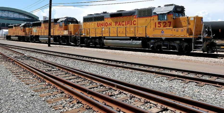 FILE - In this July 15, 2013, file photo, Union Pacific Railroad locomotives sit on a track at a rail yard in Phoenix. Union Pacific Corporation reports financial results Thursday, Jan. 19, 2017. (AP Photo/Ross D. Franklin, File)