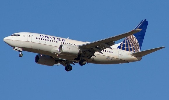 american airlines follows united bans carry on suitcases