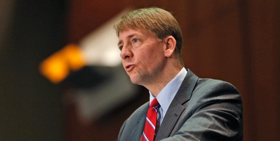 "FILE - In this March 26, 2015, file photo, Consumer Financial Protection Bureau Director Richard Cordray speaks during a panel discussion in Richmond, Va. A new CFPB report found that more than one in four consumers felt threatened when contacted by debt collectors. Cordray said the report casts a ""troubling light"" on the industry, and that the bureau is working to stop abuses. (AP Photo/Steve Helber, File)"