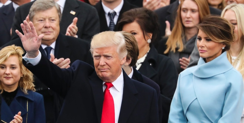 President-elect Donald Trump waves from the podium as Melania Trump looks on during the 58th Presidential Inauguration at the U.S. Capitol in Washington, Friday, Jan. 20, 2017. (AP Photo/Andrew Harnik)