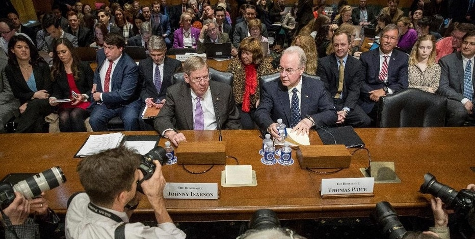Health and Human Services Secretary-designate, Rep. Tom Price, R-Ga., right, and Sen. Johnny Isakson, R-Ga. talk on Capitol Hill in Washington, Tuesday, Jan. 24, 2017, prior to the start of Price's confirmation hearing before the Senate Finance Committee. (AP Photo/Andrew Harnik)