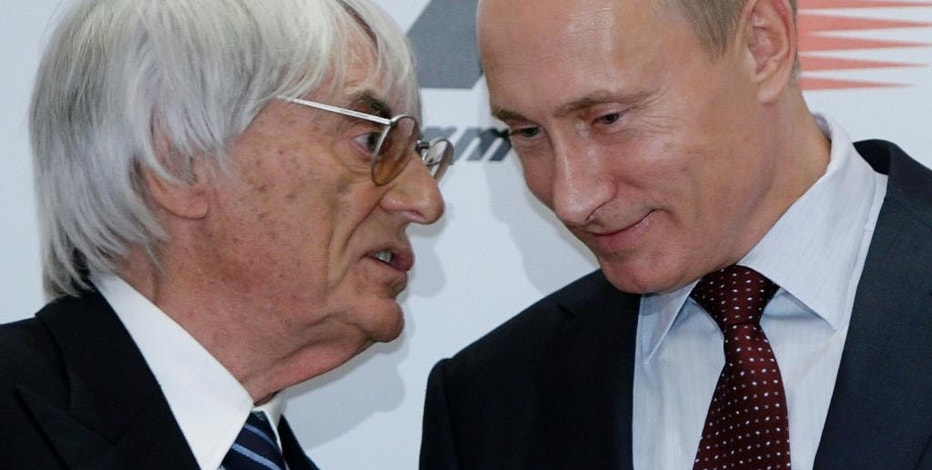 FILE - This is a Thursday, Oct. 14, 2010 file photo of  the then Russian Prime Minister Vladimir Putin, right, and Formula One chief Bernie Ecclestone as they talk during a signing ceremony in the Black Sea resort of Sochi, southern Russia. Ecclestone signed a contract with Russian officials giving Sochi the right to host the Grand Prix from 2014, the same year the city hosts the Winter Olympics. Bernie Ecclestone's reign of Formula One ended after Liberty Media officially completed its takeover of the series on Monday Jan 23, 2017.  ( (AP Photo/RIA-Novosti, Alexei Druzhinin, Pool/ File)
