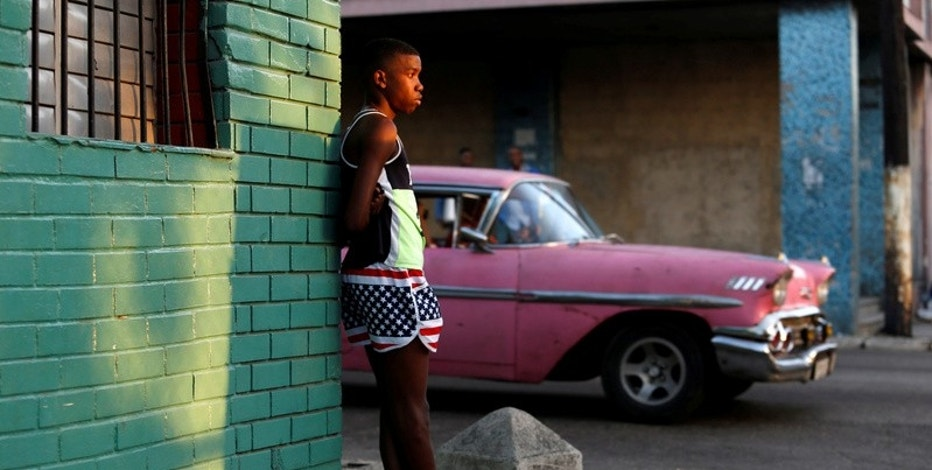 A boy wears the U.S. colors in Havana, Cuba. REUTERS/Stringer
