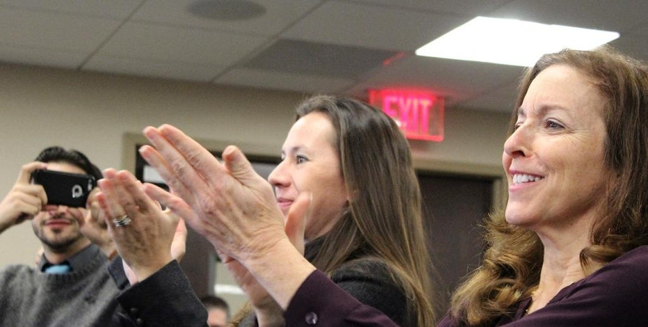 Adrienne Esposito, right, and Maureen Murphy, of the Citizens Campaign for the Environment, applaud a vote by the Long Island Power Authority at its meeting on Wednesday, Jan. 25, 2017, in Uniondale, N.Y. LIPA approved a contract with Deepwater Wind to construct a 15-turbine offshore wind project about 30 miles east of Montauk, N.Y. Environmentalists and others see the project as another step toward expanding offshore wind energy in the United States. (AP Photo/Frank Eltman)
