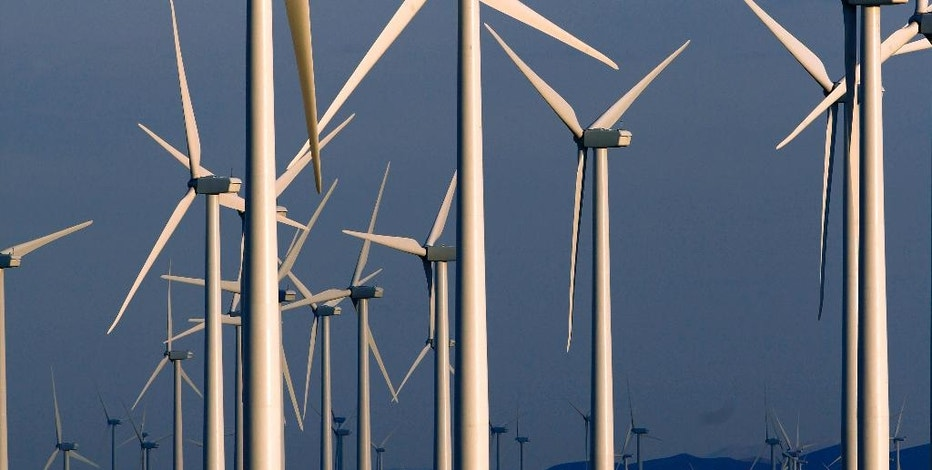 FILE - This May 6, 2013, file photo shows a wind turbine farm owned by PacifiCorp near Glenrock, Wyo. A group of Wyoming lawmakers is bucking the U.S. trend of supporting renewable energy with a plan to do the opposite: Fine utilities if they provide energy produced by wind or the sun. (AP Photo/Matt Young, File)