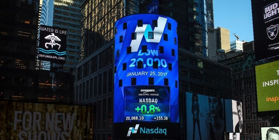In this photo provided by Nasdaq, the display at Nasdaq Tower in New York's Times Square shows that the Dow Jones industrial average closed above the 20,000-point mark for the first time, Wednesday, Jan. 25, 2017. (Rohini Shahriar/Nasdaq via AP)