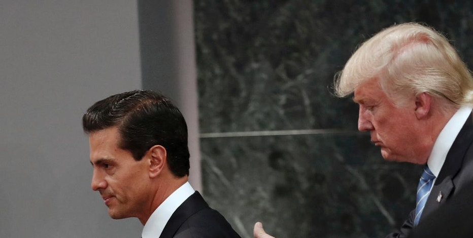 FILE - In this Aug. 31, 2016 file photo, Republican presidential nominee Donald Trump walks with Mexico President Enrique Pena Nieto at the end of their joint statement at Los Pinos, the presidential official residence, in Mexico City. President Donald Trump and Mexican President Enrique Pena Nieto spoke for an hour by phone Friday Jan. 27, 2017 amid rising tensions over the U.S. leader's plans for a southern border wall, administration officials said.(AP Photo/Dario Lopez-Mills, File)