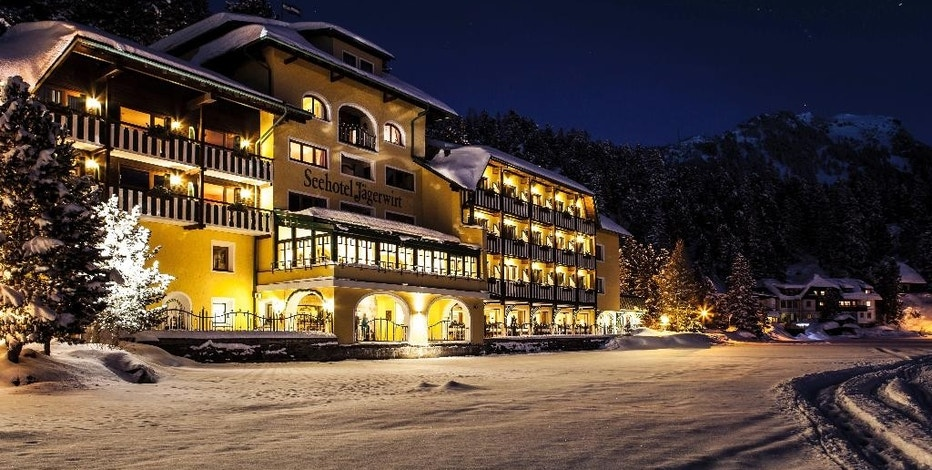 This photo, dated Dec. 2016, shows the Romantik Seehotel Jaegerwirt, a hotel in the Austrian Alps at Turracher Hoehe. The hotel's management says it is ditching its electronic room cards for the old-fashioned locks and keys after being repeatedly targeted by hackers. One recent intrusion resulted in new guests being briefly unable to access their rooms. (Seehotel Jaegerwirt via AP)