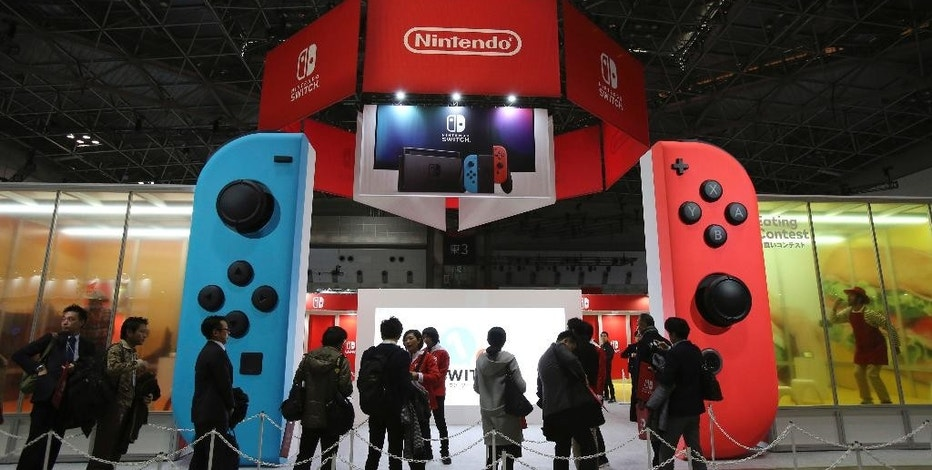 FILE - In this Friday, Jan. 13, 2017 file photo, journalists wait outside the venue for the presentation of the new Nintendo Switch in Tokyo. Japanese video game maker Nintendo Co. is reporting third quarter profit more than doubled from a year earlier on healthy sales of Pokemon game software. Nintendo, which makes Super Mario games and will start selling the Switch console March 3, reported Tuesday, Jan. 31, a better-than-expected October-December profit of 64.7 billion yen ($569 million), up from 29.1 billion yen in the same period of 2015. (AP Photo/Koji Sasahara, File)