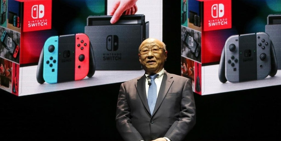 FILE - In this Friday, Jan. 13, 2017 file photo, Japanese video game maker Nintendo Co. President Tatsumi Kimishima speaks during a presentation event of the new Nintendo Switch in Tokyo. Nintendo is reporting third quarter profit more than doubled from a year earlier on healthy sales of Pokemon game software. Nintendo, which makes Super Mario games and will start selling the Switch console March 3, reported Tuesday, Jan. 31, a better-than-expected October-December profit of 64.7 billion yen ($569 million), up from 29.1 billion yen in the same period of 2015. (AP Photo/Koji Sasahara, File)