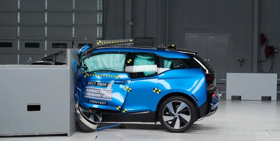 This Oct. 4, 2016, photo provided by the Insurance Institute for Highway Safety shows a 2017 BMW i3 during crash safety testing. The car earned good ratings in four out of five tests, but fell short of getting the highest safety rating in the newest crash tests administered by the insurance industry. (Matt Daly/Insurance Institute for Highway Safety via AP)