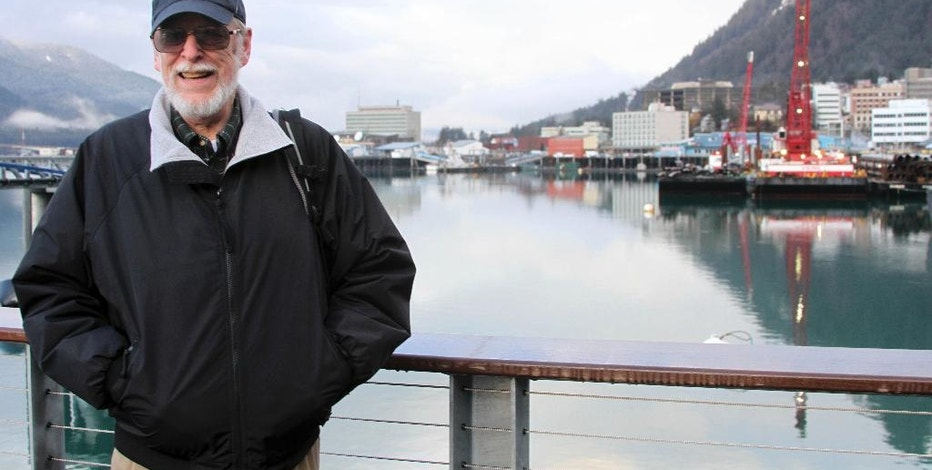 This Jan. 19, 2017, photo shows Alaska Marijuana Control Board member Loren Jones posing for a photo at the docks in Juneau, Alaska. State marijuana regulators will meet Feb. 2 to decide whether to allow retail marijuana stores to allow onsite consumption. Jones believes operators expecting to make good money off tourists are being unrealistic. He said so many states have legal marijuana now, it's silly to think people would take a cruise to Alaska just to get pot. (AP Photo/Mark Thiessen)