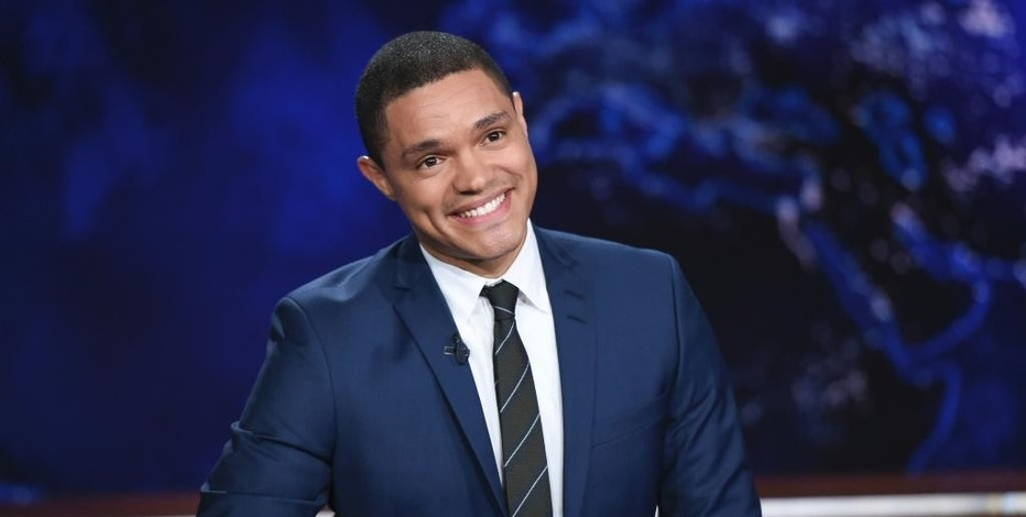 "FILE - In this Sept. 29, 2015 file photo, Trevor Noah appears during a taping of ""The Daily Show with Trevor Noah,"" a fake news series on Comedy Central, in New York. (Photo by Evan Agostini/Invision/AP, File)"