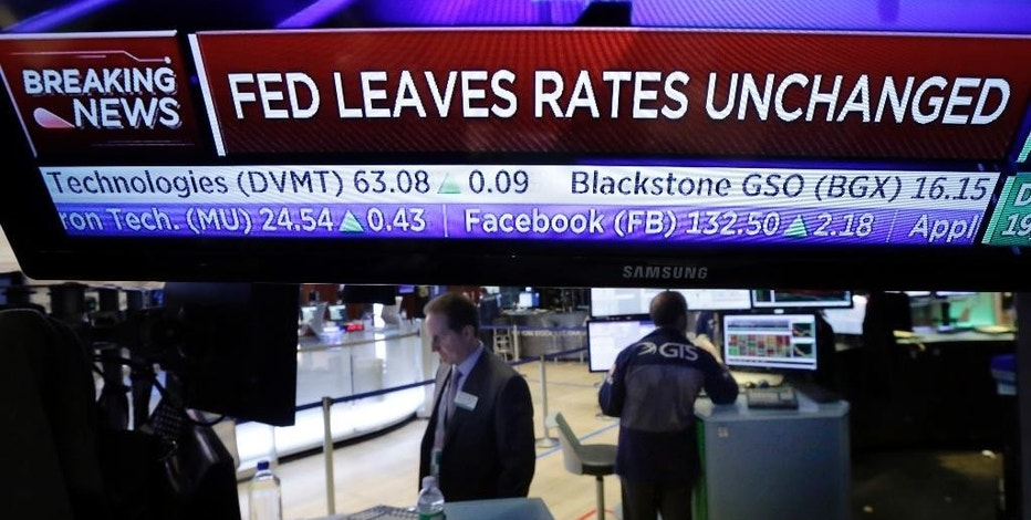 A television screen on the floor of the New York Stock Exchange shows the rate decision of the Federal Reserve, Wednesday, Feb. 1, 2017. The Federal Reserve has left its key interest rate unchanged at a time of solid economic gains but also heightened uncertainty surrounding the new Trump administration. (AP Photo/Richard Drew)