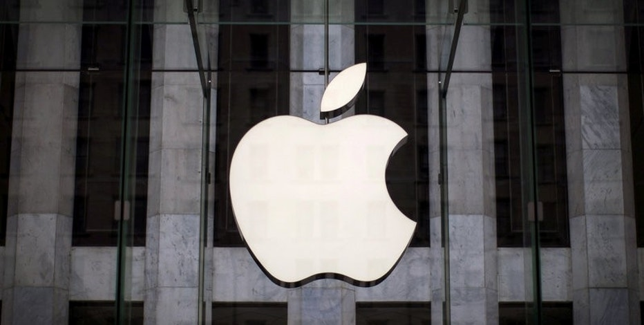FILE PHOTO: An Apple logo hangs above the entrance to the Apple store on 5th Avenue in the Manhattan borough of New York City, July 21, 2015. REUTERS/Mike Segar/File Photo