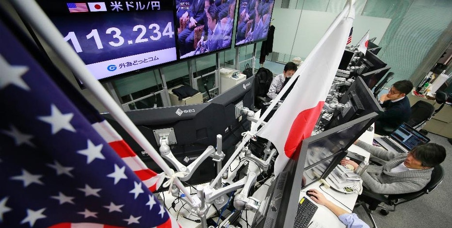 Money traders watch computer screens with the day's exchange rate between Japanese yen and the U.S. dollar at a foreign exchange brokerage in Tokyo, Wednesday, Feb. 1, 2017. Japanese officials have rejected U.S. President Donald Trump's suggestion that Tokyo is seeking to weaken the yen against the U.S. dollar to gain a trade advantage. (AP Photo/Shizuo Kambayashi)
