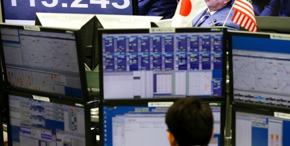 A money trader watches computer screens with the day's exchange rate between Japanese yen and the U.S. dollar at a foreign exchange brokerage in Tokyo, Wednesday, Feb. 1, 2017. Japanese officials have rejected U.S. President Donald Trump's suggestion that Tokyo is seeking to weaken the yen against the U.S. dollar to gain a trade advantage. (AP Photo/Shizuo Kambayashi)