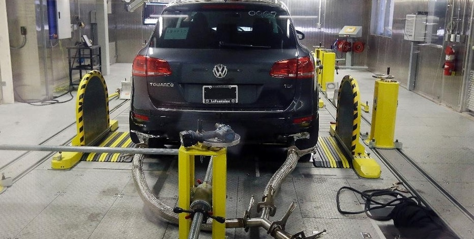 FILE - In this Oct. 13, 2015, file photo, a Volkswagen Touareg diesel is tested in the Environmental Protection Agency's cold temperature test facility in Ann Arbor, Mich. Volkswagen has agreed to pay at least US$ 1.2 billion in buybacks and compensation to settle claims from U.S. owners of cars with larger diesel engines that the company rigged to cheat on emissions tests. The proposed settlement filed late Tuesday, Jan. 31, 2017 in U.S. District Court in San Francisco covers owners of some 75,000 Audi, Volkswagen and Porsche cars with 3.0-liter diesel engines.  (AP Photo/Carlos Osorio, File)