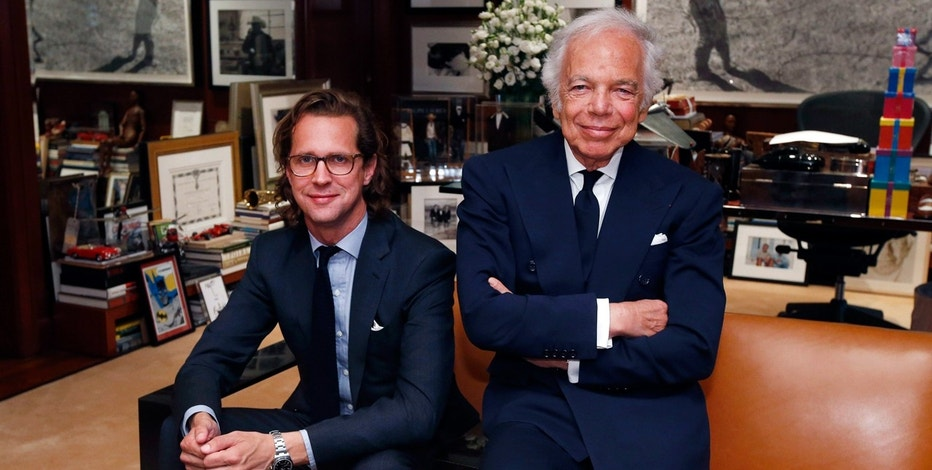 In this Sept. 29, 2015 file photo, designer Ralph Lauren, right, poses in his office with Stefan Larsson in New York.