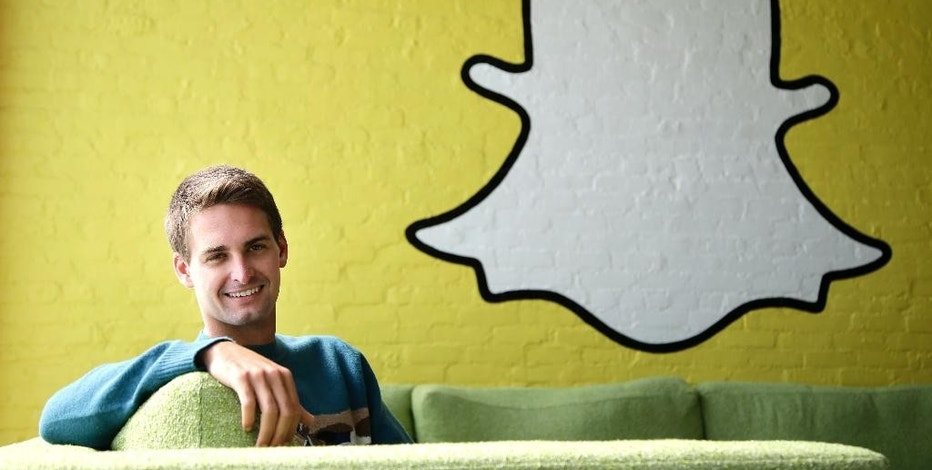 FILE - In this Thursday, Oct. 24, 2013, file photo, Snapchat CEO Evan Spiegel poses for a photo in Los Angeles. Snap Inc., owner of the ephemeral message service Snapchat, seeks to raise up to $3 billion in an initial public offering. According to IPO documents filed on Thursday, Feb. 2, 2017, Snap has lost nearly $1 billion in the past two years. (AP Photo/Jae C. Hong, File)