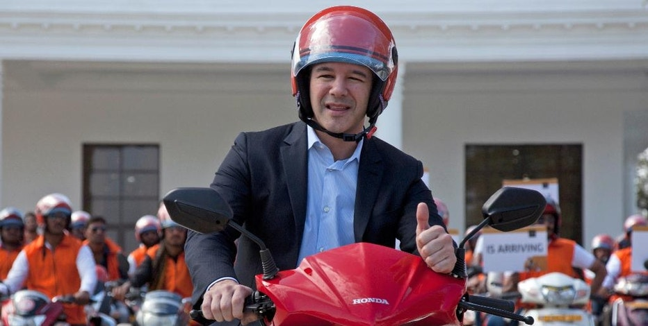 "FILE - In this Dec. 13, 2016, file photo, Uber CEO Travis Kalanick, poses during the launch of its bike-sharing product, uberMOTO, in Hyderabad, India. Kalanick has quit President Donald Trump's council of business leaders, according to an internal memo obtained by The Associated Press. Kalanick wrote to his employees that he'd spoken with Trump on Feb. 2, 2017, to ""let him know that I would not be able to participate on his economic council. Joining the group was not meant to be an endorsement of the president or his agenda but unfortunately it has been misinterpreted to be exactly that."" (AP Photo/Mahesh Kumar A., File)"