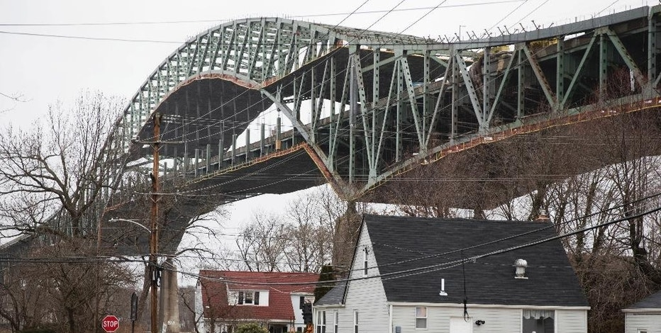 FILE - This Jan. 23, 2017 file photo shows the Delaware River Bridge in Bristol, Pa. Pennsylvania Turnpike officials say the major bridge linking the Pennsylvania and New Jersey turnpikes is expected to remain closed for repairs for at least two more months, and they are still trying to determine why one of its steel trusses fractured. The turnpike commission told The Associated Press on Friday, Feb. 3 that the Interstate 276 span over the Delaware River could reopen in early April if a repair plan goes smoothly. (AP Photo/Matt Rourke, File)