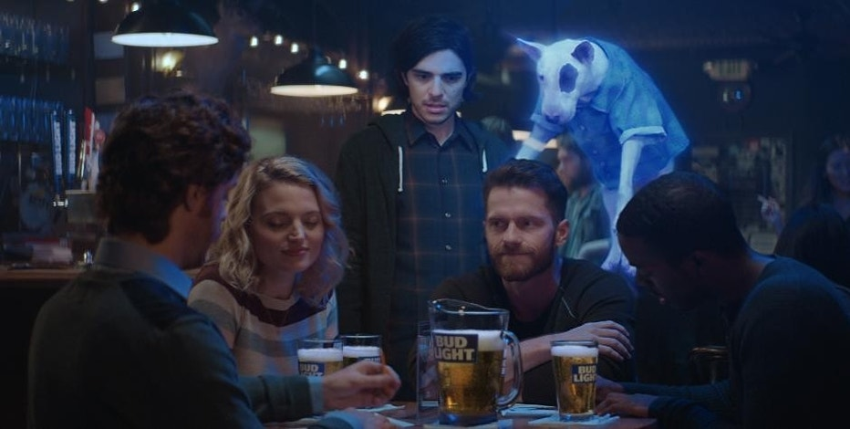 "This photo provided by Bud Light shows a scene from the company's ""Ghost Spuds,"" spot for Super Bowl 51, between the New England Patriots and Atlanta Falcons, Sunday, Feb. 5, 2017. Bud Light is re-introducing the brand's '80s pop culture icon and man's best friend, Spuds MacKenzie. (Bud Light via AP)"