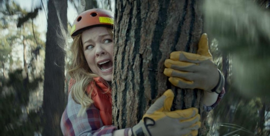 This photo provided by Kia Motors America shows a scene from the company's spot for Super Bowl 51, between the New England Patriots and Atlanta Falcons, Sunday, Feb. 5, 2017. Melissa McCarthy humorously takes on political causes like saving whales, ice caps and trees, each time to disastrous effect, in Kia's 60-second third-quarter ad to promote the fuel efficiency of its 2017 Niro crossover. (Kia Motors America via AP)