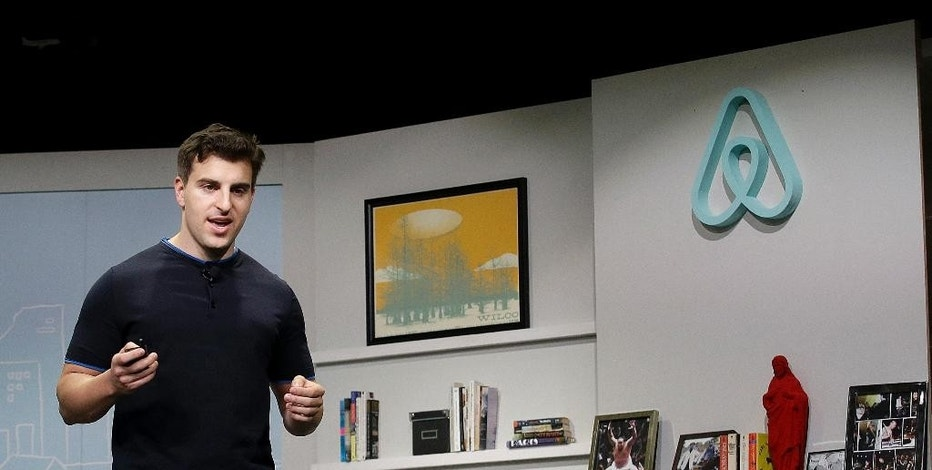 FILE - In this April 19, 2016, file photo, Airbnb co-founder and CEO Brian Chesky speaks during an event in San Francisco. Airbnb is following up its Super Bowl ad on Feb. 5, 2017, calling for acceptance with a campaign to provide short-term housing over the next five years for 100,000 people in need. (AP Photo/Jeff Chiu, File)
