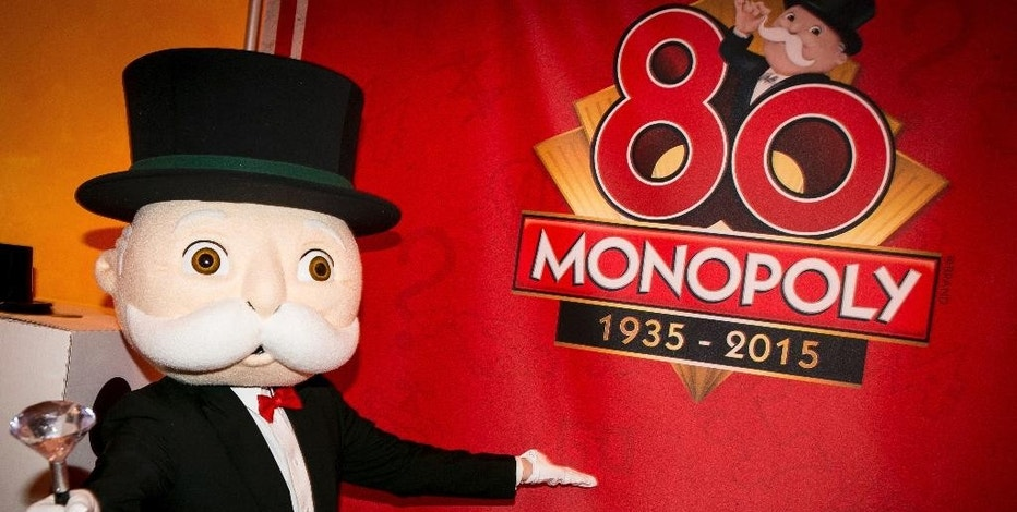FILE - In a Monday, Feb 16, 2015 file photo, Mr. Monopoly in the Hasbro showroom, to celebrate the Monopoly brand's 80th anniversary during the North American International Toy Fair in New York. Hasbro Inc. (HAS) on Monday, Feb. 6, 2017,  reported fourth-quarter earnings of $192.7 million. (Photo by Matt Peyton/Invision for Hasbro/AP Images, File)