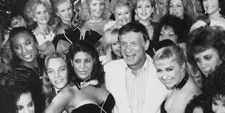 FILE - In this June 25, 1986 file photo, Playboy founder Hugh Hefner, center, poses with a group of current and former Playboy bunnies at the Playboy Club in Los Angeles, days before the club closed. The tightly corseted Playboy Bunnies, with rabbit tails and ears, will soon be back in business in New York City. Three decades after the original Playboy Club closed in Manhattan, a new club will debut later this year in a hotel a few blocks from Times Square. (AP Photo, File)