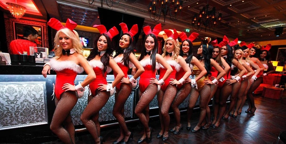 FILE - In this Dec. 18, 2010 file photo, waitresses pose inside the Playboy Club at the Sands Casino in Macau. The club closed in 2013. Three decades after the original Playboy Club closed in Manhattan, a new club will debut later this year in a hotel a few blocks from Times Square. (AP Photo/Kin Cheung, File)
