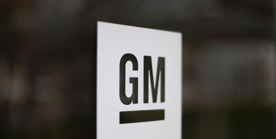 FILE - This Friday, May 16, 2014, file photo, shows the General Motors logo at the company's world headquarters in Detroit. On Feb. 7, 2017, GM reports financial results. (AP Photo/Paul Sancya, File)