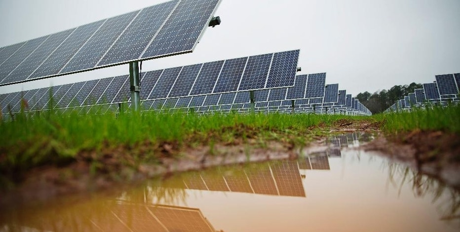 Solar panels line farmland that former President Jimmy Carter owns in his hometown of Plains, Ga., Wednesday, Feb. 8, 2017. Carter leased the land to Atlanta-based SolAmerica Energy, which owns, operates, and sells power generated from solar cells. The company estimates the project will provide more than half of the power needed in this town of 755 people. (AP Photo/David Goldman)