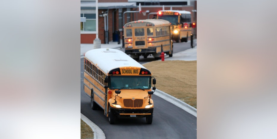 "In this Wednesday, Feb. 8, 2017 photo, West Platte School District buses drop off students at West Platte High School in Weston, Mo. Missouri Gov. Eric Greitens said his budget plan won't take a ""single penny"" out of K-12 classrooms. But a 34 percent reduction in transportation funding might keep school districts across the state from hiring new staff or buying new textbooks and technology. (AP Photo/Orlin Wagner)"