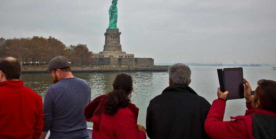 FILE - In this Nov. 5, 2015, file photo, visitors view the Statue of Liberty during a ferry ride to Liberty Island in New York. The travel industry is debating whether President Donald Trump's ban on travel from seven countries will have a larger impact on tourism in the U.S. Some experts say the controversy will have no effect while others worry that it sends an unwelcoming message to travelers around the world. An op-ed piece in the Toronto Star this week encouraged Canadians to boycott the U.S. for now, saying that the Statue of Liberty will still be there in a few years. (AP Photo/Bebeto Matthews, File)