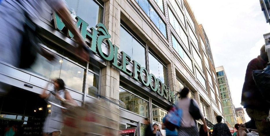FILE - In this Wednesday, June 24, 2015, file photo, pedestrians pass in front of a Whole Foods Market store in Union Square in New York. Whole Foods said Wednesday, Feb. 8, 2017, that sales fell 2.4 percent at established locations, marking the sixth straight quarter of declines as it faces competitive pressures. (AP Photo/Julie Jacobson, File)