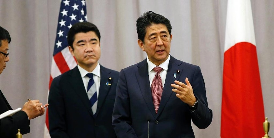 FILE - In this Nov. 17, 2016, file photo, Japanese Prime Minister Shinzo Abe, right, gestures as he answers questions from the media after meeting with then U.S. President-elect Donald Trump during his stopover in New York en route to an APEC meeting in Lima, Peru. Japan is charting its own course to deal with the radically different U.S. president, an approach that will be tested when Abe meets Trump in the White House on Friday, Feb. 10, 2017 - and on the golf course in Florida. (AP Photo/Kathy Willens, File)