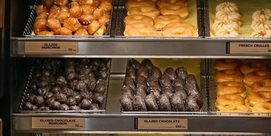 This Thursday, July 28, 2016, photo shows donuts for sale at a Dunkin' Donuts in Edmond, Okla. Dunkin' Brands Group, Inc. reports financial earnings Thursday, Feb. 9, 2017. (AP Photo/Sue Ogrocki)