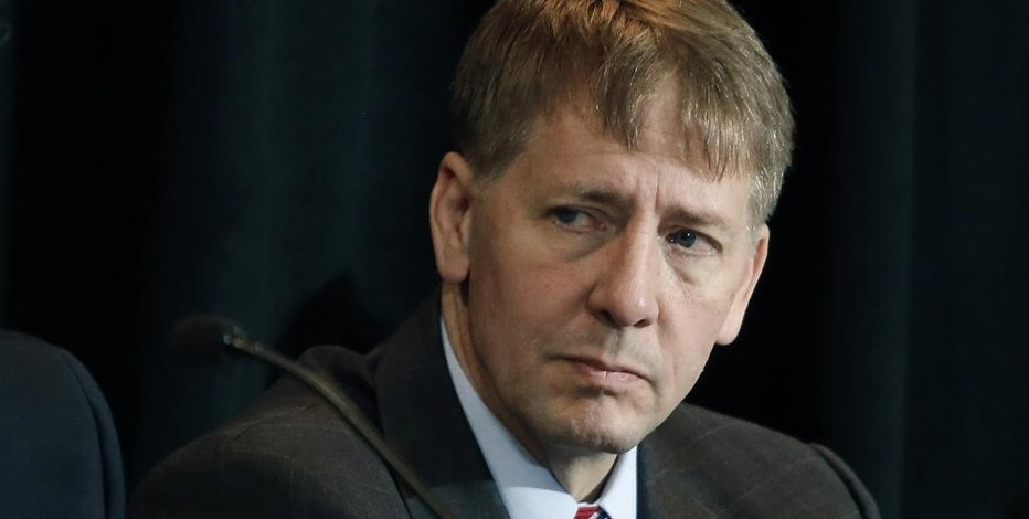 FILE - In this Wednesday, Oct. 7, 2015, file photo, Consumer Financial Protection Bureau Director Richard Cordray listens to a speaker during a a hearing in Denver. Just three weeks into his administration, President Donald Trump and his allies are moving quickly to dismantle the web of regulations the government passed after the 2008 financial crisis to tighten oversight of banks and protect consumers and taxpayers. The CFPB has been a prime target for Republican lawmakers who have long accused it of regulatory overreach. (AP Photo/Brennan Linsley, File)