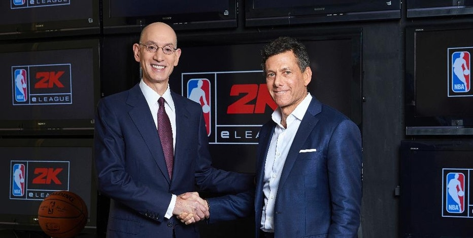"In this photo provided by NBA, NBA Commissioner Adam Silver, left, and Take-Two CEO Strauss Zelnick pose for a photo at the NBA headquarters in New York, N.Y. Wednesday, Feb. 8, 2017. Video gamers now have a chance to compete for an NBA title, in an actual NBA arena and get paid by the some of the same people who pay LeBron James and Steph Curry. The ""NBA 2K eLeague"" is coming, the first eSports league operated by one of the four major pro sports leagues in the United States. (Jenn Pottheiser/NBA via AP)"