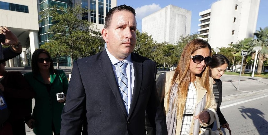 FILE - In this Feb. 1, 2017, file photo, baseball trainer Julio Estrada, left, leaves federal court in Miami. Prosecutors have shown jurors in the trial of sports agent Bartolo Hernandez and Estrada, that dozens of player documents are bogus. The documents are required for Cuban players to enter the U.S. and to negotiate lucrative free agent contracts. (AP Photo/Lynne Sladky, File)