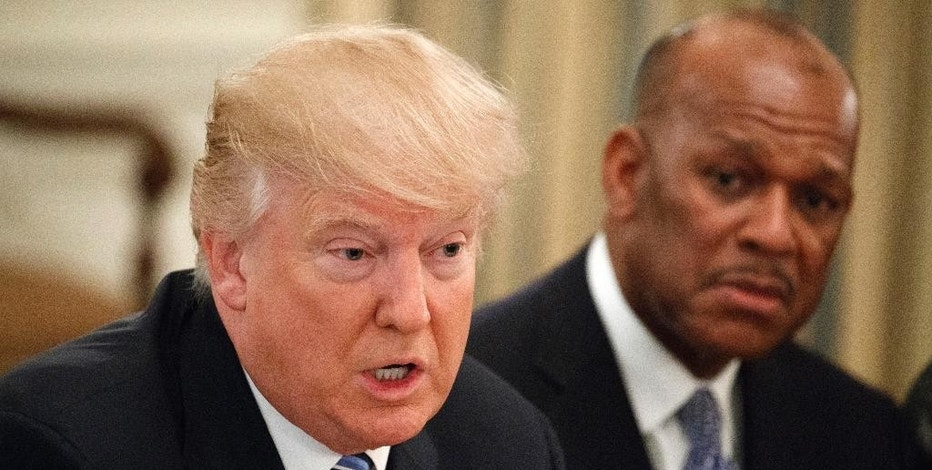 UPS President of US operations Myron Gray listens at right as President Donald Trump speaks during a meeting with airline executives in the State Dining Room of the White House in Washington, Thursday, Feb. 9, 2017. (AP Photo/Evan Vucci)
