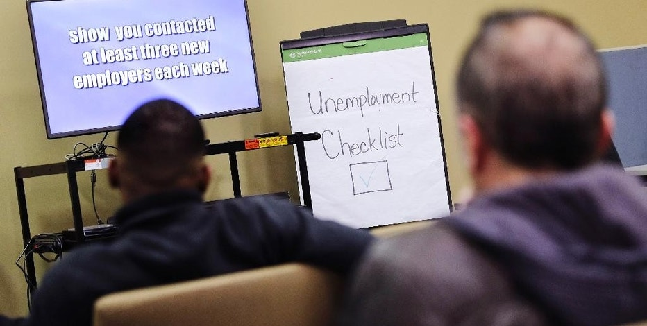 FILE - In this Thursday, March 3, 2016, file photo, people attend an employment orientation class at the Georgia Department of Labor office in Atlanta. On Thursday, Feb. 9, 2017, the Labor Department reports on the number of people who applied for unemployment benefits in the previous week. (AP Photo/David Goldman, File)