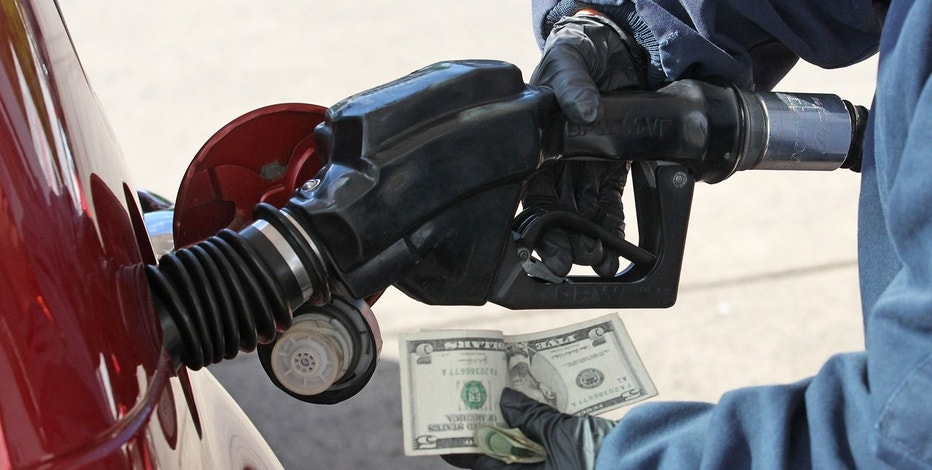 Gas station, driver pumping gas holding money FBN