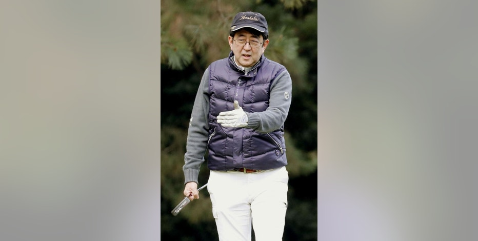 In this Dec. 29, 2016, photo, Japanese Prime Minister Shinzo Abe gestures on a golf course in Chigasaki, west of Tokyo. If they stick to schedule, Abe and U.S. President Donald Trump will spend more time on the fairway than at the White House. After facing off on some divisive issues in Washington on Friday, Feb. 10, 2017, they are jetting to Florida, where they will turn to something they have in common on Saturday: a love of golf. (Hideaki Arai/Kyodo News via AP)